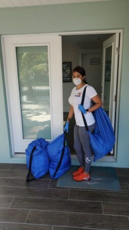 housekeeper wearing a face mask